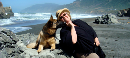 dolly-with-her-german-shepherd-on-the-beach